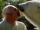 Polar bear purrs when cuddling with her human dad